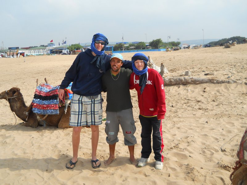 Max, Angus, and Mustafa on the beach in Essaouira