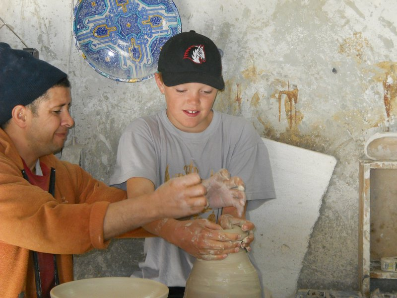 Angus giving the pottery wheel a try