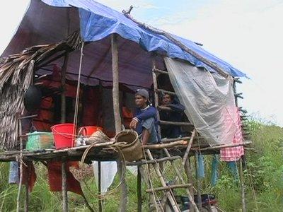 A Jakun youth taking a break in a hut