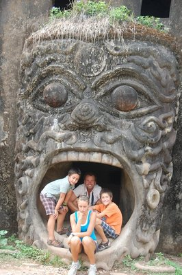 Playing in the mouth of an awesome, giant, surreal pumpkin at Xieng Khuan.