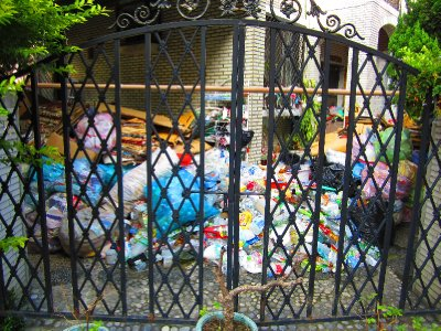 The amount of garbage puzzled me, as this was the front entrance to the home