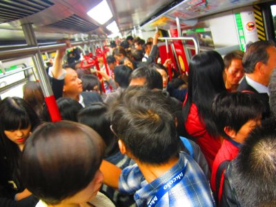 Rush Hour in the MTR.  This was when it became a bit less traffic so that my arms became mobile to take the picture.
