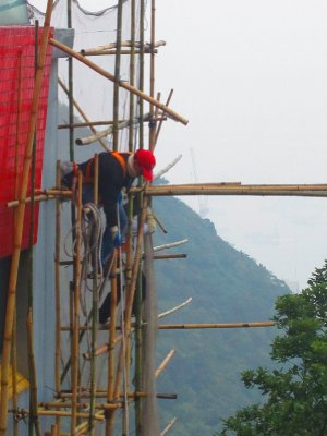 More brave workers atop bamboo scaffolding