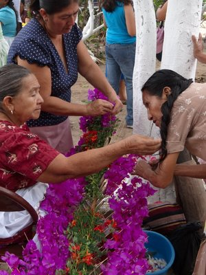 Ladies frantically making the flower displays