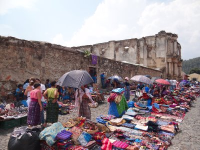 Typical colourful market against the ruins