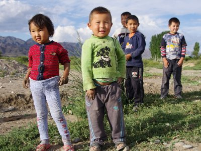 Kyrgyz children approach us near our campsite