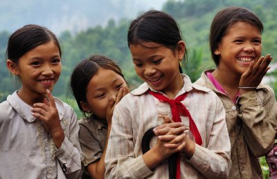 School girls crowd round us on the road in North East Vietnam, 3 October 2012