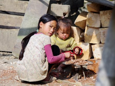 Children playing in their backyard in Lao Chai, Sapa