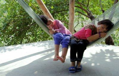 Mr Hoan's children relax at their family homestay near Ninh Binh