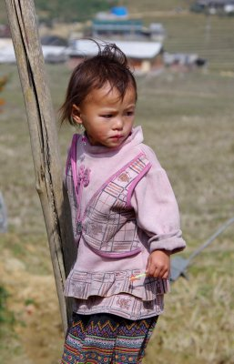 This young girl was outside her nursery school in her home village of Lao Chai. She was so photogenic I photgraphed her twice.