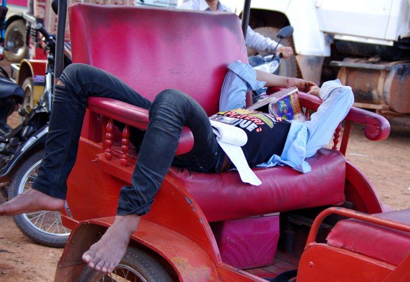 A typical Cambodian tuk tuk driver
