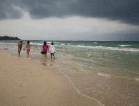 Holiday makers on the beach at Thung Wau Laen