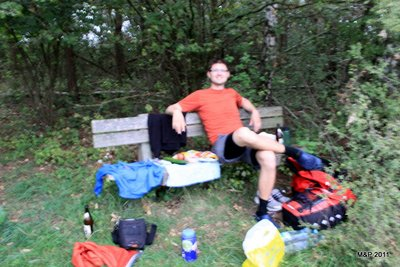 An unfortunately blury photo of our dinner on a bench near our tent