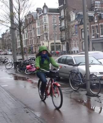 Jennifer keeping dry in the bike lane near our apartment in Amsterdam