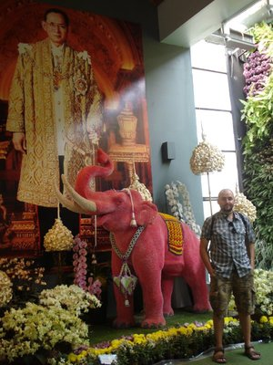His Majesty King Bhumibol Adulyadej, a pink elephant made of flowers and Robert McGraw