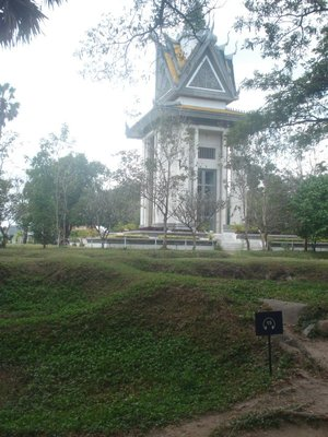 Mass Graves with Memorial Stupa at Killing Fields