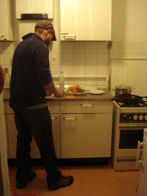 Robert cutting veggies in our kitchen in Amsterdam