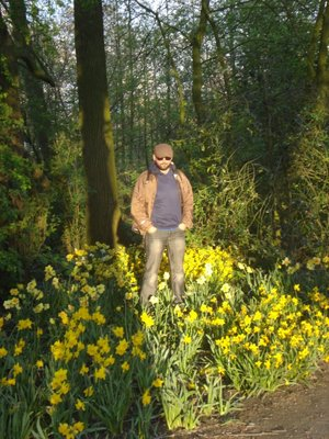 Robert taking in the sunset in a flower patch in Vondelpark