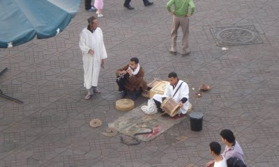 Snake Charmers in Marrakech; if you walk too close to these guys, they will throw a snake around your neck and expect a tip for doing so.