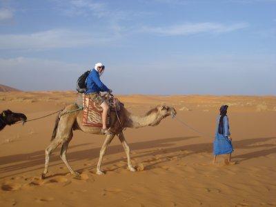 Robert on a camel in the Sahara Desert