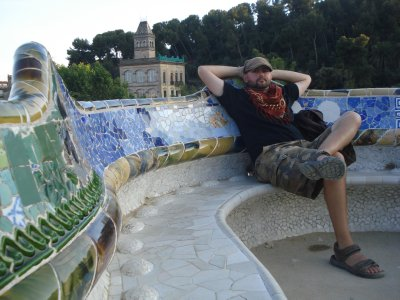 Robert relieved that the sun went down, resting on the beautiful mosiac bench at Parc Guell, Barcelona