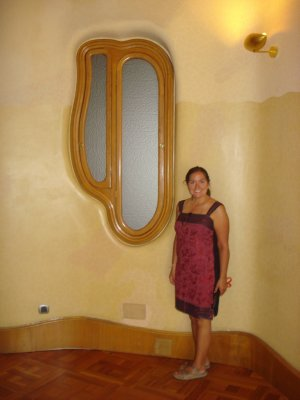 Jennifer and an interior window at Casa Batlló.  Gaudí is known for using curved lines.