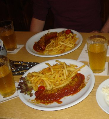 Currywurst and Apfelwein.  Tastes as good as it looks!