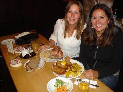 Jennifer and Sabina enjoying some traditional German food:  Sauerkraut, Schnitzel and Schweinshaxe (Pork Knuckle).  Super tasty!