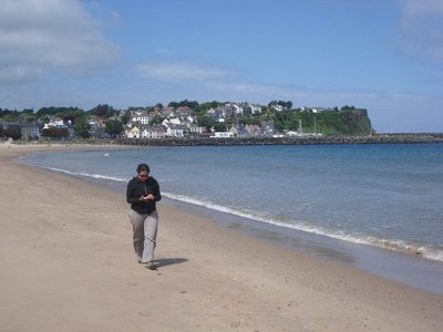 Jennifer walking on the beach in Ballycastle, Northern Ireland