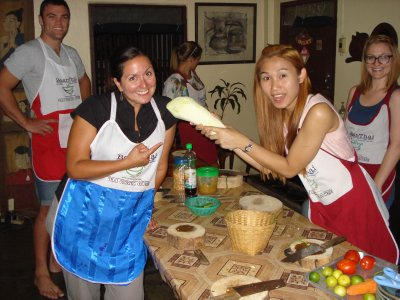 Jennifer and our teacher, Quan, messing around with a huge papaya