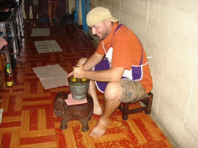 Robert grinding ingredients for green curry paste