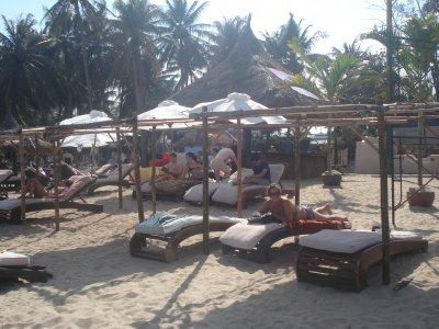 Jennifer lounging on the beach in Nha Trang