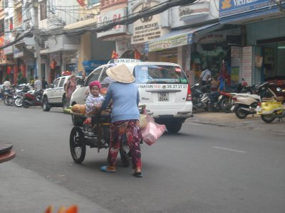 Adorable baby riding on cart in Ho Chi Minh City