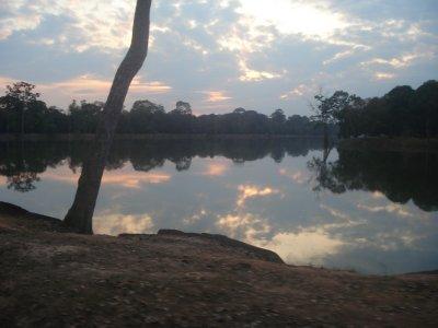 Moat surrounding Angkor Wat at sunset