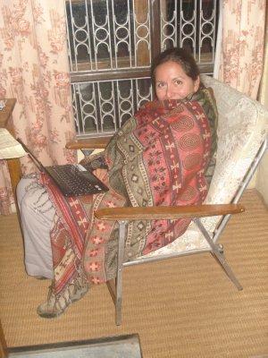 Jennifer breaking in our $4 blanket, cheaper than spending $5/day on firewood.