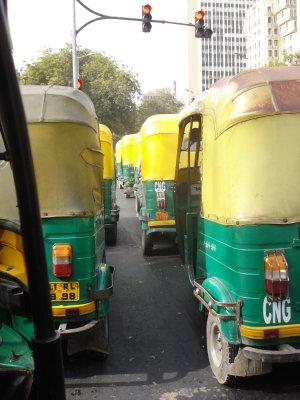 Tuk-tuks at a red light in New Delhi