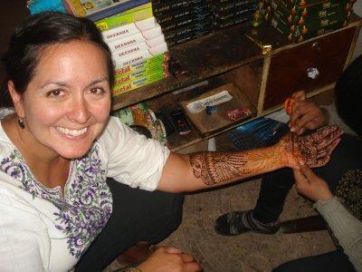Jennifer getting a henna tattoo