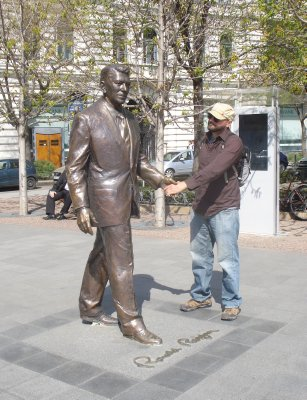 "Robert shaking hands with a ""life-sized"" statue of President Reagan in Budapest's Freedom Square.  Who knew he was over 8 feet tall?"