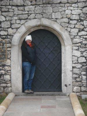Jennifer escaping the cold in a doorway near Wawel Castle, Krakow, Poland