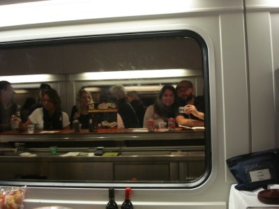 Our reflection in the window in the bar car of our overnight train from Paris to Madrid