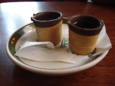 Madroño, a sweet, fruity liqueur served in a chocolate shot glass that you can eat.  Madrid, Spain