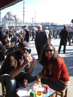 Robert and Jennifer chowing down a fish sandwich from the floating fish market on the Bosphorus