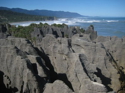 Pancake Rocks, With The Picturesque Drive of The West Coast In The Background