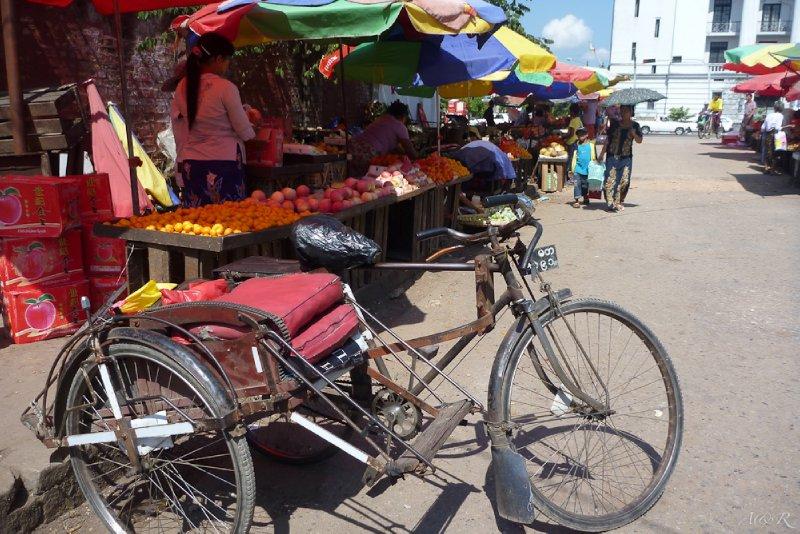 Yangon's colourful plastic stalls with rusty bikes