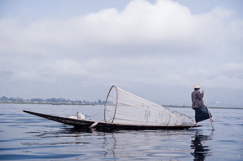 The highly photogenic traditional leg rowing fisherman