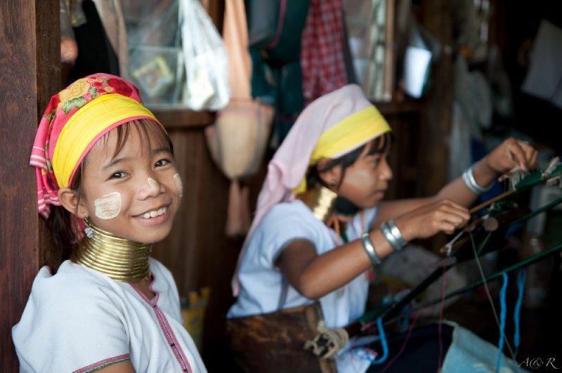 Kayan Lahwi or Padaung tribe girls weaving traditional garments
