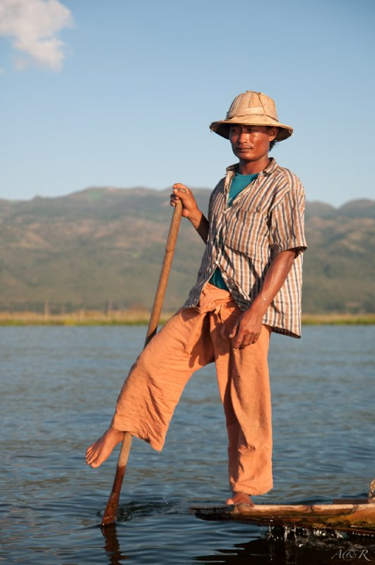 Traditional leg rowing fisherman, culturally significant and unique to the region