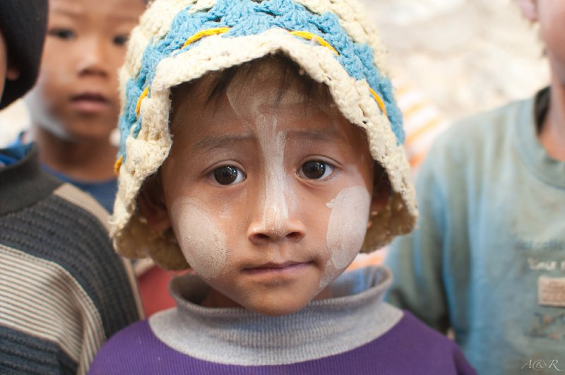Each child has thanaka expressively painted on their faces!