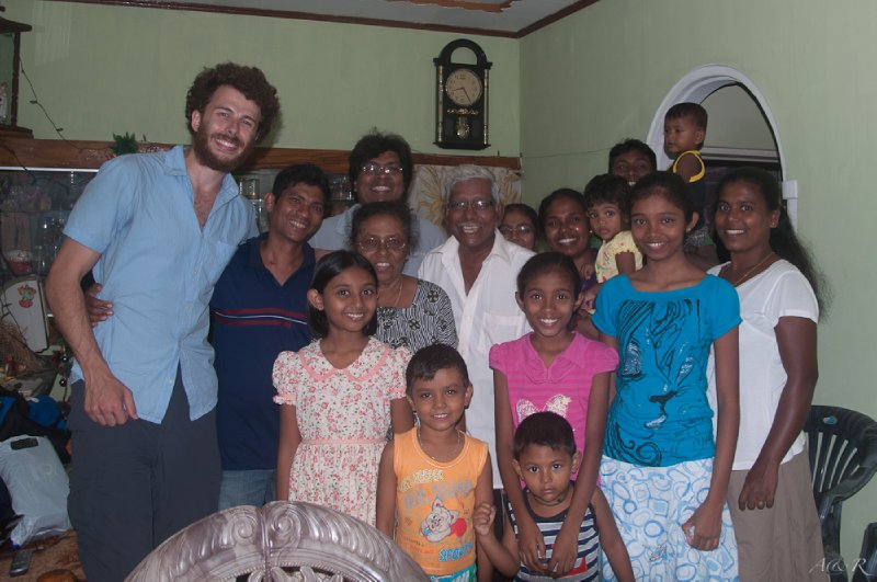 Big smiles all around as Adam towers over our hosts in Chilaw