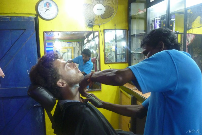 $1.50 for a beard trim and shave, as well as a head, shoulder and arm massage. No, I didn't get a haircut